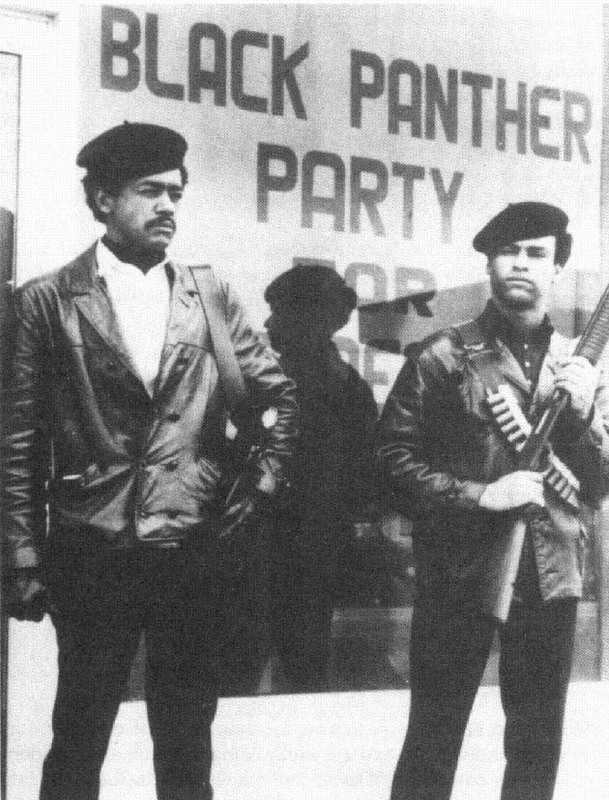 Bobby Seale and Huey P. Newton Standing outside Black Panther Headquarters in Oakland, California
