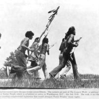 Participants running in the 1978 Longest Walk carrying a sacred pipe across Illinois