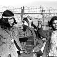Young Native Americans giving the Red Power Salute