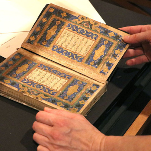 """A closer look at a book of Persian Sufi poetry, ca. 1541, installed in the exhibit """"The Hargrett Hours: Exploring Medieval Manuscripts."""""""
