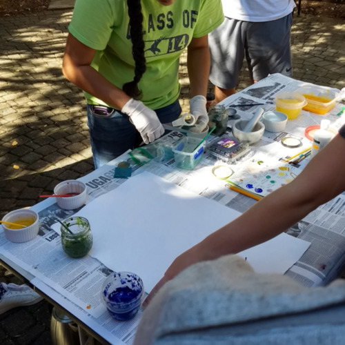 Photograph, UGA students experimenting with making pigments and painting illustrations in the style of medieval manuscripts.